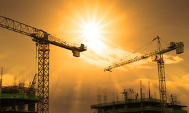 foto of land development  - file of crane and building construction and sun set sky - JPG