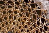 Abstract  Closeup Of Patterns And Textures On Wicker Weave On Chair