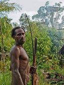 Korowai With Bow And Arrows