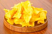 picture of fruit platter  - Yellow dehydrated mango fruit on wood platter - JPG