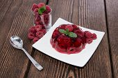 picture of jello  - Portion of fresh made Raspberry Jello on a plate - JPG