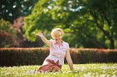 Enjoyment. Positive Emotions. Outgoing Old Woman Resting On Grass