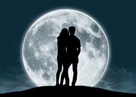 foto of moon silhouette  - silhouette of a young couple in love looking at the full moon - JPG