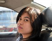 Asian Woman Sitting In Car