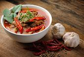 foto of curry chicken  - Delicious Thai panang curry on wood background - JPG