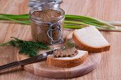 Sandwiches with pate, with glass jar on a background