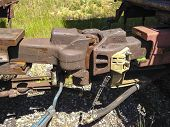 pic of railroad car  - Two railroad cars are attached to each other by the means of these heavy metal interlocking couplers - JPG