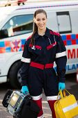 attractive female paramedic holding portable devices