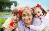 Happy Grandmother With Grandchildren Outdoors