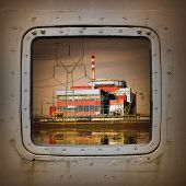 pic of nuclear disaster  - Nuclear power plant on the coast wiew from steel window - JPG