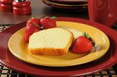 pic of pound cake  - Slices of pound cake with fresh ripe strawberries - JPG