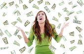 picture of money  - Stock image of ecstatic woman trying to catch falling money - JPG
