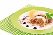 Tasty homemade apple strudel mint leaves and ice-cream on plate isolated on white
