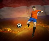 Abstract waves aroun soccer player on the national flag background