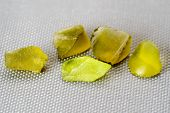 picture of uncut  - Set of five peridot crystals in green on grey mat - JPG