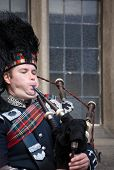 Edinburgh, Uk - April 26, 2013: Scottish Bagpiper Playing Music With Bagpipe At Edinburgh In Scotlan
