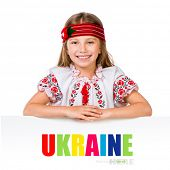 pic of national costume  - happy little girl in the Ukrainian national costume behind white board with space for text - JPG