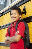 stock photo of pre-teen boy  - Pre teen boy with school bus - JPG