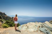 Woman Looking Out Over Mediterranean Coast From Cap Corse In Corsica
