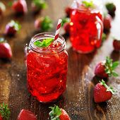 strawberry cocktail in jar with deep red color