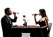 couples lovers dinning drinking wine in silhouettes on white background