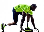 pic of amputee  - one muscular handicapped man starting line  with legs prosthesis in silhouette on white background - JPG