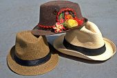 foto of panama hat  - A collectrion of fedora and panama hats. One of fedoras with Kuna Ayala panamenian indian crafts.