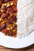 Chili Con Carne And Rice On A White Plate Macro Vertical