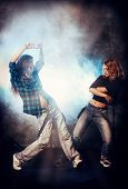 Modern hip-hop dancers over grunge background. Urban, disco style.