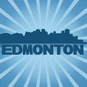 Edmonton skyline reflected with blue sunburst illustration