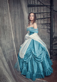 image of pompous  - Beautiful young woman in blue medieval dress on the stairway - JPG