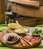 picture of charcuterie  - different italian antipasti and red wine - JPG