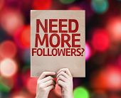 Need More Followers? written on colorful background with defocused lights