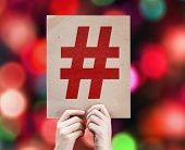 picture of hashtag  - Hashtag Icon written on colorful background with defocused lights - JPG
