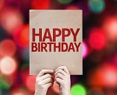 Happy Birthday written on colorful background with defocused lights