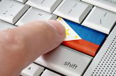Business Concept Male Finger Pressing Philipines Enter Key On Metallic Keyboard