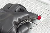Hacking Japan Concept With Hand Wearing Black Leather Glove Pressing Enter Key With Flag Overlaid