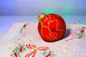 Red Christmas ball on a napkin