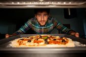 picture of take out pizza  - Image of man taking pizza from oven - JPG