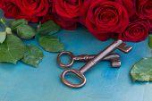 Keys with crimson roses