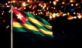 Togo National Flag City Light Night Bokeh Background 3D