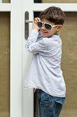 portrait of boy with sunglasses, external