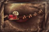 Santa Claus taking off his sleigh led by reindeers on a snowing night