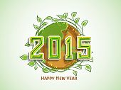 Happy New Year 2015 celebration with earth covered by green leave for save nature concept.