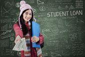 Schoolgirl In Winter Wear Giving Student Loan