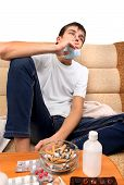 pic of teen smoking  - Sick Teenager smoking Cigarette on the Sofa with the Pills on foreground - JPG