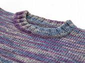 Fragment of a knitted woolen jumper
