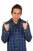 handsome young latin man wearing a blue plaid shirt posing with fingers pointing up