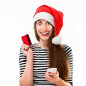 Woman with credit card on Christmas