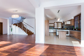 picture of enormous  - Enormous empty living room with wooden floor - JPG